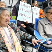 Former 'comfort women' join a protest in front of the Japanese Embassy in Seoul in November. | KYODO