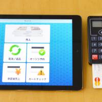 A mobile device from Mitsubishi UFJ Nicos Co. is used to let customers to pay at their tables in restaurants. | KYODO