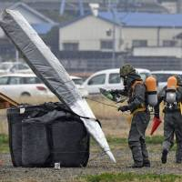 Ground Self-Defense Force troops conduct a November emergency missile drill in Unzen, Nagasaki Prefecture, in which a ballistic missile is presumed to have injured residents. The defense budget will swell to a record ¥5.19 trillion for fiscal 2018 as the nation shores up its defenses against provocative North Korea. | KYODO