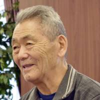 Tetsuro Ahiko, born in the province of Sakhalin in 1930 when it was under Japanese administration and later detained in Kazakhstan, speaks at the Embassy of Kazakhstan in Tokyo on Dec. 22. | KYODO