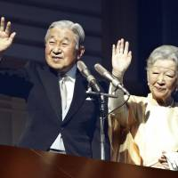 Accompanied by Empress Michiko, Emperor Akihito greets the public at the Imperial Palace on his 84th birthday on Saturday. He is scheduled to abdicate on April 30, 2019. | KYODO