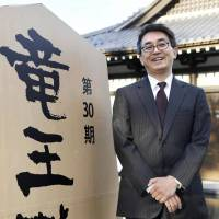 Shogi player Yoshiharu Habu poses for a photo Wednesday in Ibusuki, Kagoshima Prefecture, a day after he won the Ryuo title, making him the first-ever player to win a seventh eisei lifetime title. | KYODO