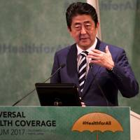 Prime Minister Shinzo Abe delivers an opening speech at the Universal Health Coverage Forum, on Dec. 14 in Tokyo. | AFP-JIJI