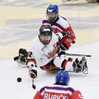 Japan and the Czech Republic compete in the men's para ice hockey final qualifying match in Ostersund, Sweden, on Oct. 14. | KYODO