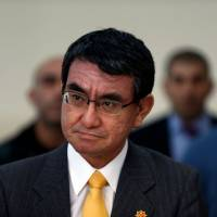 Foreign Minister Taro Kono visits the West Bank city of Jericho on Tuesday. He released a statement while on tour in the Middle East rejecting a South Korean government report on the so-called 'comfort women' deal reached two years ago. | AFP-JIJI