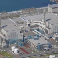 Two Niigata nuclear reactors run by Tepco clear new safety standards, a first for the company since the Fukushima crisis
