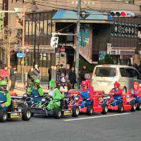 Tourists decked out in 'Mario Kart' costumes and driving rented go-karts will soon be required to fasten their seat belts after a spate of accidents. | MAGDALENA OSUMI