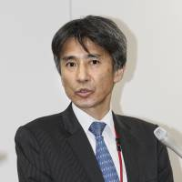 Japan Atomic Energy Agency executive director Hajime Ito speaks to reporters Wednesday after submitting to the Nuclear Regulation Authority a 30-year decommissioning plan for the Monju fast-breeder nuclear reactor. | KYODO
