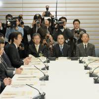 Prime Minister Shinzo Abe (right) speaks during a meeting Tuesday at his office in Tokyo. | KYODO