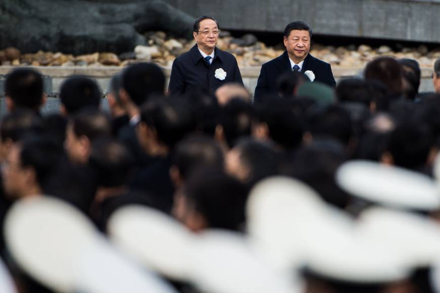 Chinese President Xi Jinping attends a memorial ceremony at the Nanjing Massacre Memorial Hall on the second annual national day of remembrance to commemorate the 80th anniversary of the massacre in the city on Wednesday. | AFP-JIJI