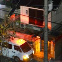 Police investigate a house Thursday in Ikoma, Nara Prefecture, where a woman allegedly stabbed her son's 8-year-old classmate earlier in the day. | KYODO