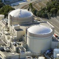 Oi reactors No. 1 (front) and No. 2, run by Kansai Electric Power Co. in the town of Oi, Fukui Prefecture, have been scheduled to be decommissioned. | KYODO