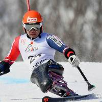 Skier Takeshi Suzuki, gold medalist in the men's slalom sitting category at the 2014 Sochi Paralympics, competes at a World Cup event in Hakuba, Nagano Prefecture, on March 5. | KYODO