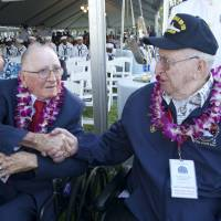 Pearl Harbor survivors remember comrades killed in Japanese attack 76 years ago