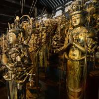 The last set of overhauled Kannon bodhisattva are placed at Kyoto's Sanjusangendo Hall on Friday, ending a 45-year cleanup job. | KYODO