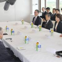 Chief Cabinet Secretary Yoshihide Suga makes economic, safety pledges to future base host Nago