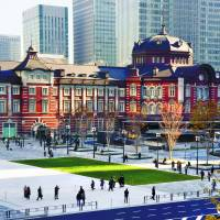 People walk across a new plaza on the Marunouchi side of Tokyo Station on Thursday. The plaza provides easier access to the Imperial Palace. Construction on the project, a collaboration between JR East and the Tokyo Metropolitan Government, began in 2014. | SATOKO KAWASAKI
