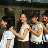 Seina Otsuki (second from right), a Sendai high school student, poses with other students and a member of Vietnam-based Hoa Ban Plus, a firm that supports the Tay, a Vietnamese minority group, sporting earrings featuring a tribal design. | COURTESY OF RYOSUKE SUGAYA