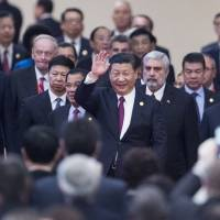 Chinese President Xi Jinping arrives at the Great Hall of the People in Beijing on Friday for the opening ceremony of a three-day meeting of political parties from around the world. | AFP-JIJI