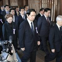 Hidehisa Otsuji (far right), of the ruling Liberal Democratic Party, and other lawmakers visit the war-linked Yasukuni Shrine in Tokyo on Tuesday. | KYODO
