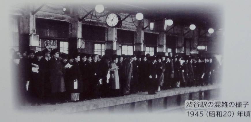Commuters wait for a train on a platform on the Ginza Line in 1945.