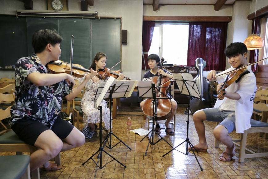A quartet rehearses during the Ozawa International Chamber Music Academy Okushiga in Nagano Prefecture in July.