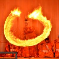Lit up: A priest performs the Dance of Fire at the Akiha Fire Ceremony in Hamamatsu.
