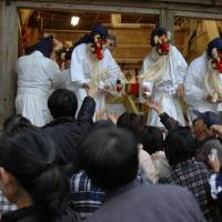 Foul mouths allowed: Priests dressed as goblins hand out lucky charms during the Akutai Festival.