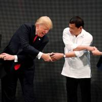 Getting handy: Vietnamese Prime Minister Nguyen Xuan Phuc, U.S. President Donald Trump, Philippine President Rodrigo Duterte and Australian Prime Minister Malcolm Turnbull participate in the opening ceremony of the ASEAN Summit in Manila in November. | REUTERS