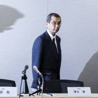 An unfortunate turn of events: Shigehisa Takada, chairman and CEO of Takata Corp., leaves a news conference in June. | BLOOMBERG