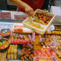 Fresh fish: A vendor restocks a display of sushi at Karato Market in Shimonoseki, Yamaguchi Prefecture. | LILY CROSSLEY-BAXTER