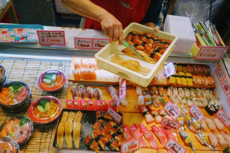 Fresh fish: A vendor restocks a display of sushi at Karato Market in Shimonoseki, Yamaguchi Prefecture.
