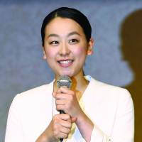 Skating off: Mao Asada speaks to the press after announcing her retirement on her blog in April. | KYODO