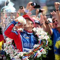 Fuel for the champ: Takuma Sato celebrates his Indy 500 victory with a traditional swig of milk. | USA TODAY SPORTS / VIA REUTERS