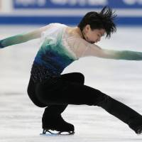 The iceman cometh: Yuzuru Hanyu skates at the world championships in Helsinki in April. | AP