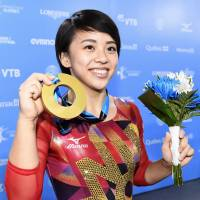 Top spot: Mai Murakami shows off her gymnastics gold in Montreal in October. | KYODO