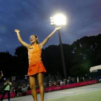Game, set, match: Kimiko Date thanks fans at the Japan Women's Open in September. | KYODO