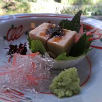 A tofu lunch course includes fish and other delectables, enjoyed at a restaurant overlooking the Kibune River. | AMY CHAVEZ