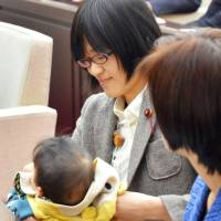 Baby steps: Kumamoto city council member Yuka Ogata  received an official warning for bringing in her 7-month-old son to the assembly hall on Nov. 22, an action she hoped would make raise awareness of the issues working mothers face. | KYODO