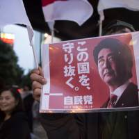 Gamble pays off:  The threat of nuclear attack by North Korea and disarray among the opposition  helped Shinzo Abe and his Liberal Democratic Party  clinch victory in the snap Lower House election in October. | BLOOMBERG