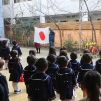 Eyes right: Tsukamoto Kindergarten in Osaka, run by scandal-tainted private operator Moritomo Gakuen, holds a morning assembly in February. | KYODO