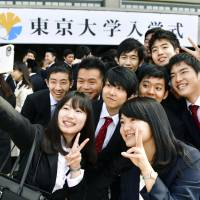 New University of  Tokyo students attend their entrance ceremony in April. | KYODO