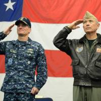U.S. Navy Rear Adm. Marc H. Dalton (left), commander of Expeditionary Strike Group 7, and Navy Adm. Harry Harris salute aboard the USS Bonhomme Richard at a June 29 ceremony marking the start of Talisman Saber, a biennial joint military exercise between alliance partners Australia and the United States. | NAVY MEDIA CONTENT SERVICES