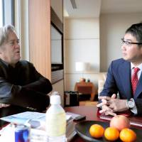 Former Trump adviser Steve Bannon meets with Katsuyuki Kawai, a member of the Lower House and a special assistant to the LDP president on foreign policy, on Monday in Tokyo. | KYODO