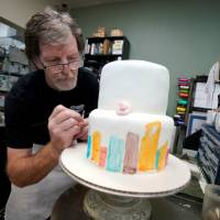Baker Jack Phillips decorates a cake in his shop in Lakewood, Colorado, on Sept. 21. Phillips refused to make a wedding cake for a gay couple on religious grounds. | REUTERS