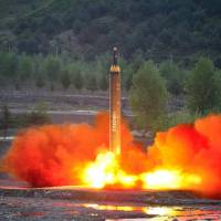 Blast threat: An intermediate-range ballistic missile test is conducted by North Korea on May 14. | KYODO