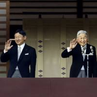 The royal wave: The Imperial Family wave to well-wishers during their traditional New Year's greetings at the Imperial Palace. | KYODO