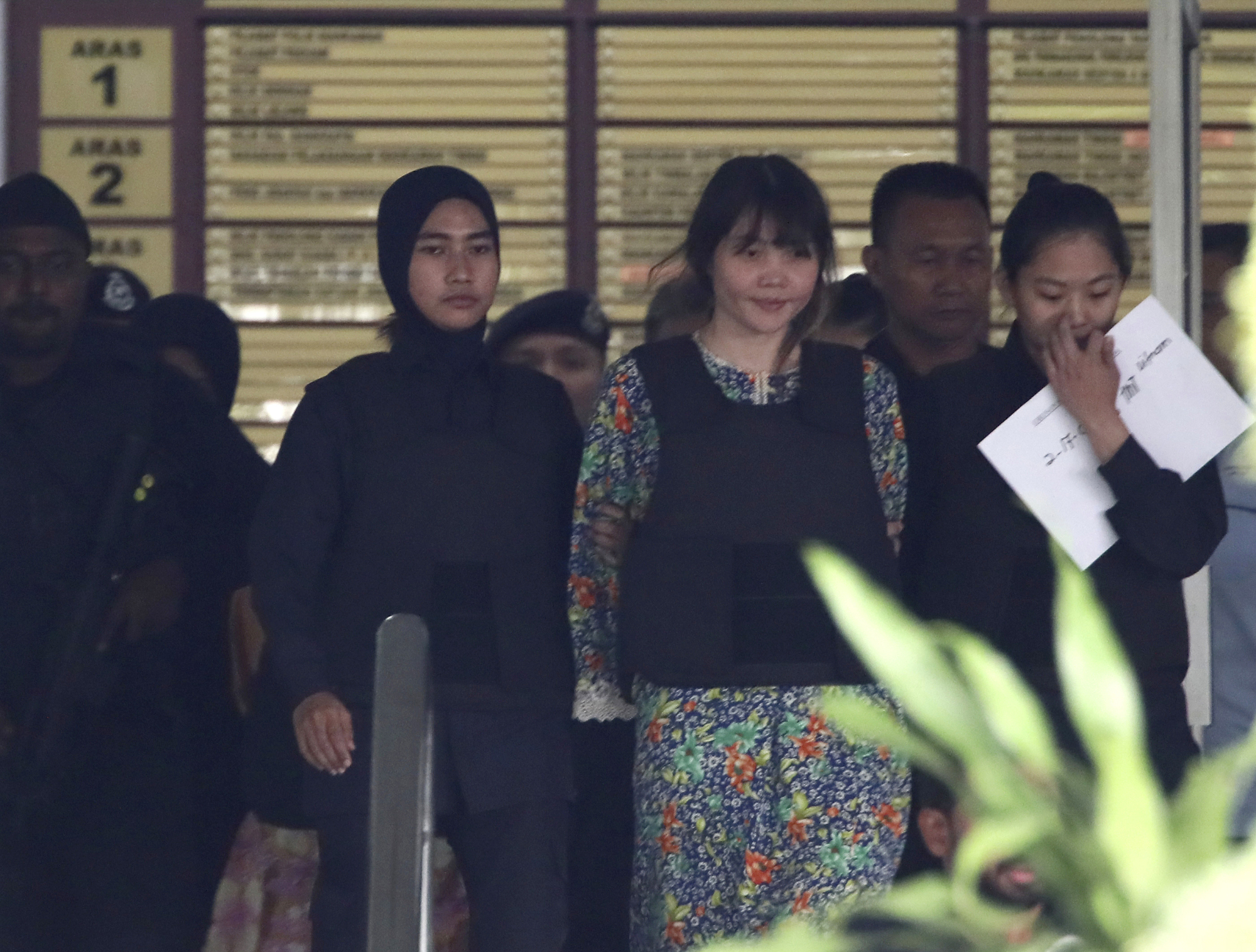 On trial: Vietnamese Doan Thi Huong is escorted by police as she leaves a court hearing in Shah Alam, outside Kuala Lumpur, in October.