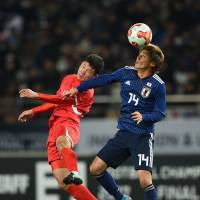 Japan's Junya Ito (right) had an impressive debut with the national team during Japan's 1-0 win over North Korea on Saturday night. | AFP-JIJI
