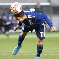 Japan's Yu Kobayashi, seen heading the ball against China in an E-1 Football Championship match on Tuesday night at Ajinomoto Stadium, broke a scoreless deadlock in the 84th minute. Japan won 2-1. | KYODO